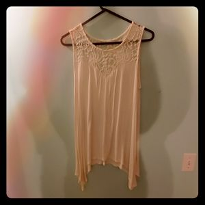 Lace top tank with 'high-low' cut sides